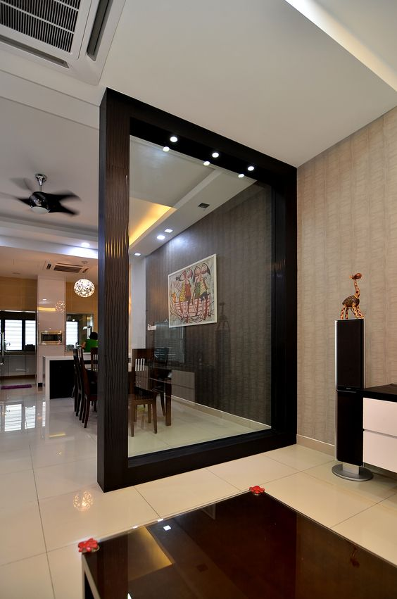 Wooden partition with glass to separate dining place from for Living room dining room partition designs