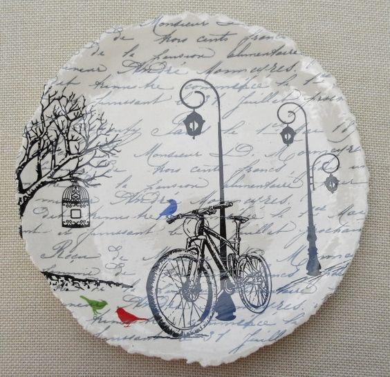 Handmade plate with silk screened decal motif.
