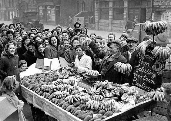 'ave a banana!' Bethnal Green, East London in 1946. Smiling women queuing for the much awaited bananas which have been scarce since the beginning of the Second World War.