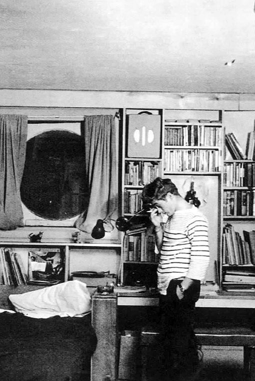 James Dean in his New York apartment, 1955.: