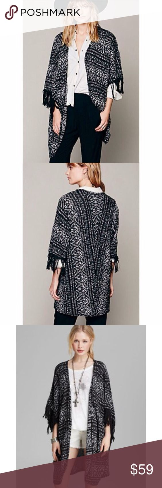 Free People Black White Aztec Kimono Cardigan A FREE PEOPLE black and white oversized knit kimono with an Aztec pattern and fringe tassels... Lightweight enough for summer with a pair of shorts or as a beach cover up... No signs of wear or tear, size M/L... A very cool statement piece... Comment with any questions! Free People Sweaters Shrugs & Ponchos: