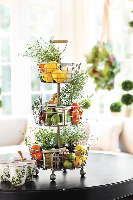 3-tiered wire basket storage in the kitchen for fruit & small pots of fresh herbs