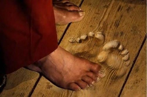"""human footprints worn into a wooden floor mark the spot where a 70-year-""""old Buddhist monk named Hua Chi, has said his prayers in a temple in Tongren, China, for over twenty years.    More than 1 1/2 inches deep in some places, the prints tell the story of unbelievable prayer frequency, which according to Hua Chi at one point occurred over 3,000 times per day!"""""""
