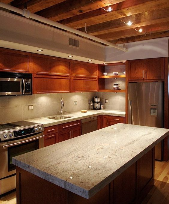 The wood ceiling and cabinets in this kitchen are beautiful on their own but it's the granite that really makes everything look its best. This slab on the island is definitely thick and heavy and the sharp edges and corners create a more rustic look to finish it off.