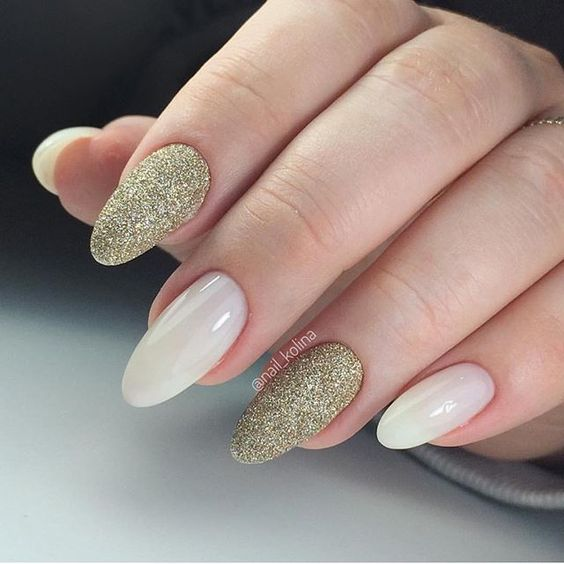 Milky white and gold glitter nails