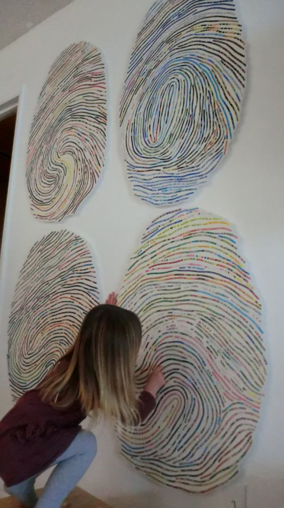 I WANT THIS!!!! Thumbprint portraits use your child's own thumbprint to create a large (three feet high!), colorful work of art that he or she will absolutely love.:
