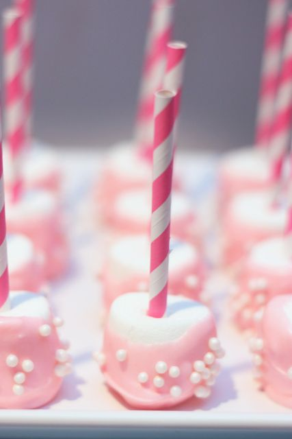 "Girly marshmallow pops: Add fun ""pearl"" sprinkles to pink candy coating before it dries"