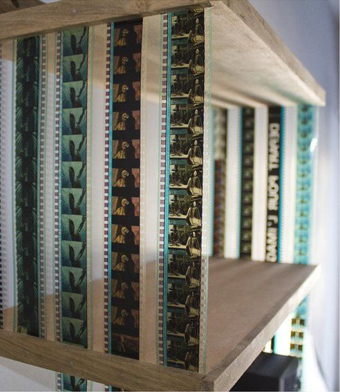 Strips of movie film + wood = collapsible shelves