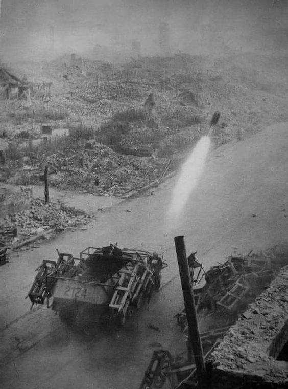 "The Wurfrahmen 40 (""launch frame 40"", here in action against Polish positions during the Warsaw Uprising) was a German World War II multiple rocket launcher. It combined a vehicle such as the SdKfz 251 half-track or a captured ex-French Renault UE Chenillette with rocket artillery to form a more mobile and protected artillery piece than the towed Nebelwerfer. It was nicknamed Stuka zu Fuss (""Stuka on Foot"" or ""Walking Stuka"") and Heulende Kuh (""Bellowing Cow"")."