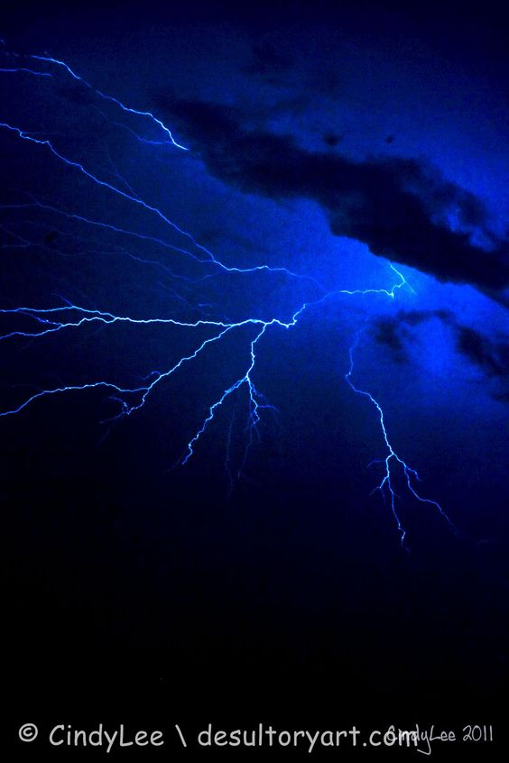 Lightening racing sideways across the night sky