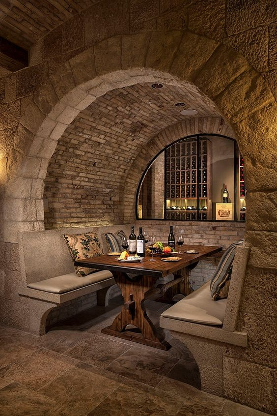 Wine cellar and celebration area... I am totally in love with this space! Love the wood & stone.