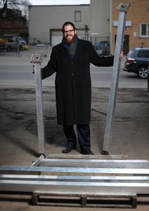 Rabbi Moshe Goldman with some of the pieces of a giant menorah that will be put together in the Waterloo Public Square for the upcoming Hanukkah celebration.