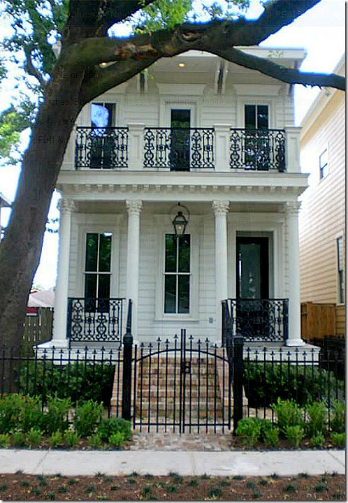 Wrought Iron Railing Panels Between Wood Columns Over The