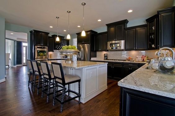Mixing black cupboards with a white island and topping all of it with Kashmir white granite is elegant.You will have a modern and top of the line kitchen with this.