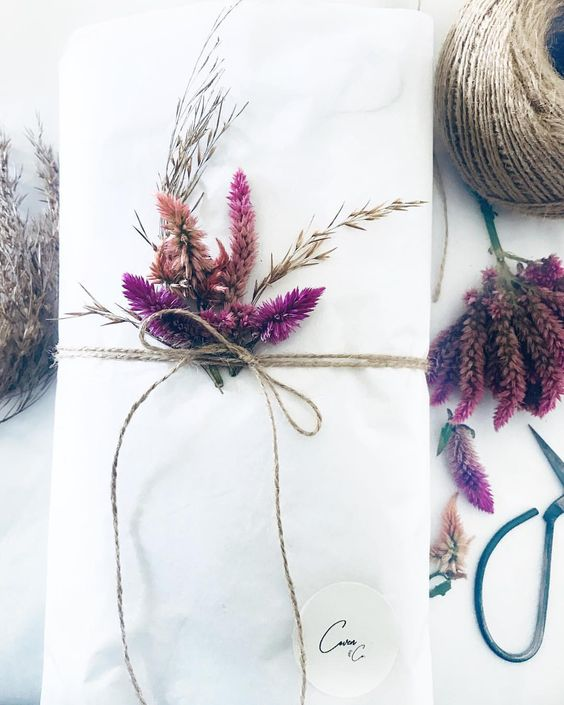 Coven and Co. gift wrapping with dried flowers and twine. Celosia boho bohemian present ideas