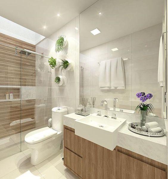 Banheiro | Com estilo clean, o banheiro de hóspedes mistura tom de madeira e branco, o destaque fica por conta dos vasinhos com suculentas que levam para o espaço um pouco da natureza. O banheiro social também pode ter charme, porque não? 👍🏼