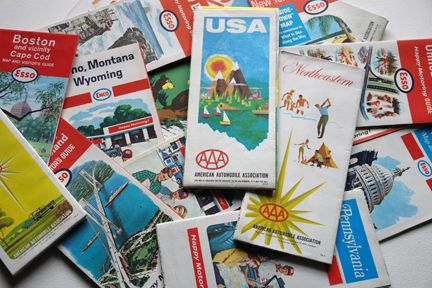 pile of vintage travel maps from the 1960s: