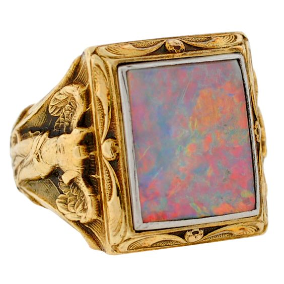 """BAILEY BANKS & BIDDLE Art Nouveau Opal Gold Victory Ring  ca. 1900  This fabulous Art Nouveau opal ring is detailed with 2 """"Winged Victory"""" women. These winged beauties decorate the shoulder of this magnificent ring which has a large square opal set flush within its 14kt yellow gold setting. The firey opal has beautiful vibrant colors with hues of red, orange, blue and green. This rare Art Nouveau ring may be worn by either a man or a woman and would make any collection complete!"""