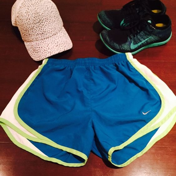 Nike DryFit shorts in bright blue and lime sz. S Great condition Nike DryFit shorts in bright blue with a lime green lining. Has inner lining for running. Sz. Small. No trades. No PayPal Nike Shorts