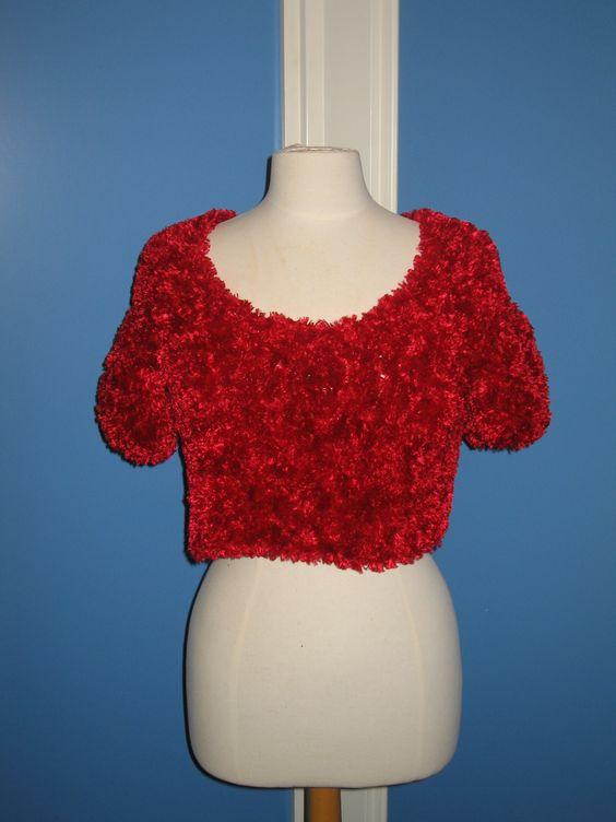 Truitje rood tot in de taille  maat 42  polyesther  gebreid Te koop of te huur