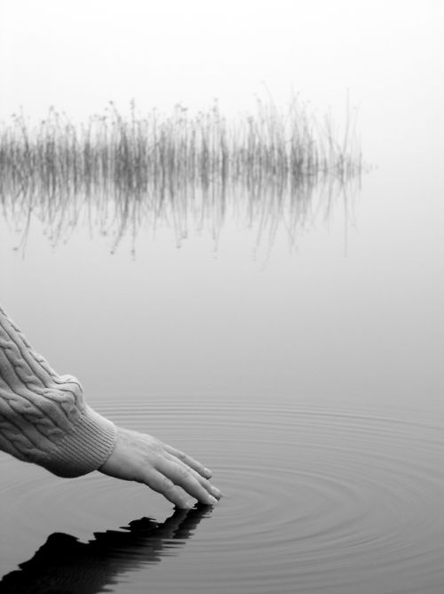 hand on still water image