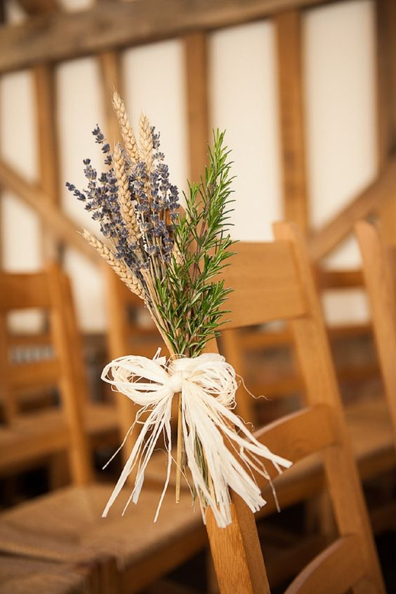 Wheat, Rosemary and Lavender tied with raffia make for charming aisle markers in this rustic/barn wedding. This is a fun and fragrant combination of wedding flowers!