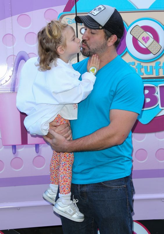 "Little kisses are just what the doctor ordered. Joey Fatone makes a new friend at Disney Junior's ""Doc McStuffins"" Doc Mobile tour stop on Sept. 26 in Los Angeles"