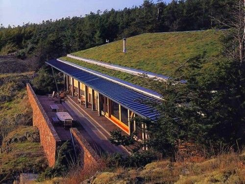 large earth-sheltered home with a grand design | Underground house ...