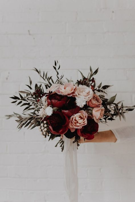 Christmas greenery and the prettiest pink + red roses | Image by Olivia Strohm Photography