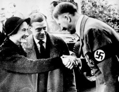 Adolf Hitler kisses the hand of the Duchess of Windsor as her husband the Duke looks on, admiringly. They visited Germany in 1937 before WWII broke out.   At the beginning of the war, the Windsors were whisked out to safe haven in the Bahamas, he served out the war years as governor. There he could do Britain little harm - and he was less likely of being kidnapped by the Germans who were reportedly interested in installing him as a puppet king in a conquered Great Britain under German rule.