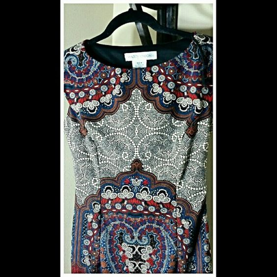 Perfect Slip on Work Dress......Size 4 Poloyester  and Spandex. Dress is lined. Beautiful Pattern. Zipper down the side. Maggy London Dresses Midi