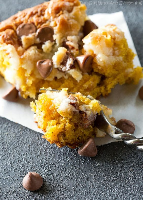 Pumpkin Earthquake Cake - a moist pumpkin cake with coconut, pecans, and swirled with a cream cheese mixture. You want to make this for fall! the-girl-who-ate-everything.com