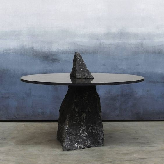 Dutch designer Lex Pott imagined a furniture collection titled Fragments for the design platform The Future Perfect. Three of the pieces are tables that play on the idea of fragmented stones. In fact, each coffee tables is held by feet made of big black stones' blocks. These interior furnitures creates a dialogue between an irregular nature and a polished geometry.