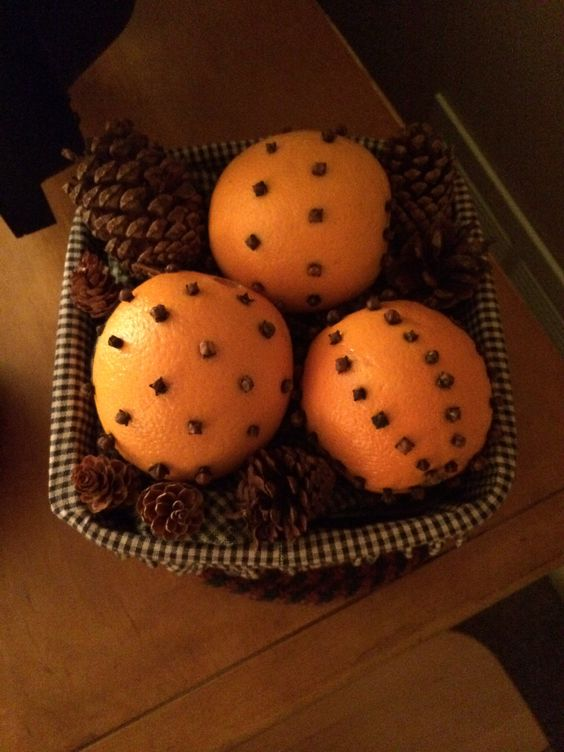 Made these last night - Oranges & Whole Cloves - The smell is WONDERFUL!  Display in a basket or a bowl.  Add pinecones or any filler.  Also will try other citrus fruits.