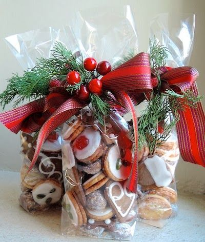 I Love This Idea Of Wrapping & Presenting Your Home Made Goodies With A Little Greenery & A Bright Red Christmas Bow...Give Out To ALL Of Your Friends & Family & They'll Absolutely Love It Knowing You Went Through That Little Extra Step To Show That You Care,  Instead Of Handing Them A Plain Ol' Plate Of Cookies......:
