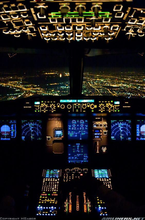Inside the cockpit of a Wizz Air A320 Approaching to Budapest in the night.: