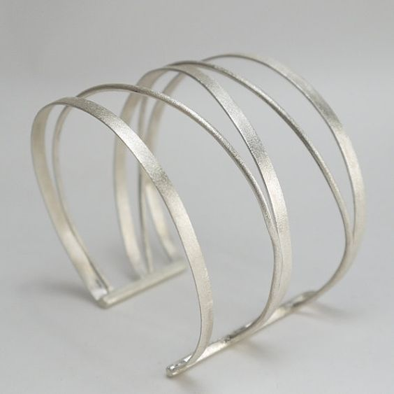 Statement silver cuff. Made of silver wires inspired of ancient Rome and Greek bracelets in a new modern design.