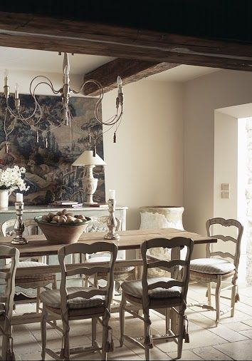French Country Dining Room ~ beamed ceilings, antique chandelier, long wooden farm table, ladder back chairs. - lil' designer