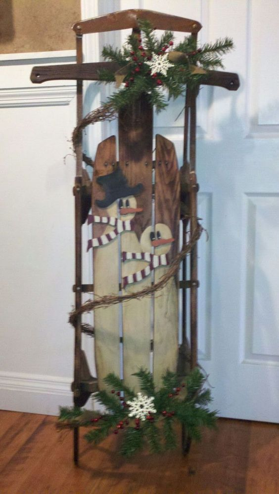 Sled snowman and sled decor on pinterest for Antique sled decoration