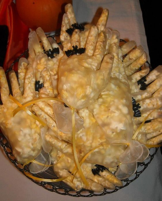 Witches Hands | Plastic gloves filled with popcorn, wearing spider/bat rings
