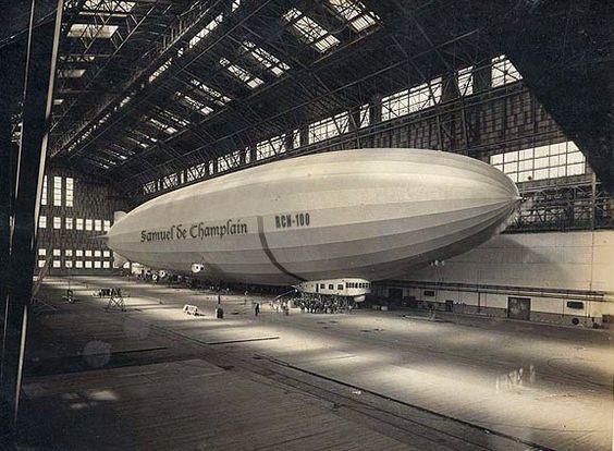 Samuel de Champlain was a 2,472,000 cubic foot rigid airship built by the Zeppelin Company at Friedrichshafen, Germany. Here she rests at Lakehurst. Her construction was partially funded by German World War I reparations. Completed in August 1924, she departed Germany in mid-October 1926 for delivery to the Royal Canadian Navy.  www.airshipcenter.com