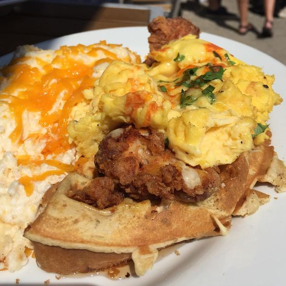 Chicken and Waffles Benedict (Southern Fried Boneless Chicken Thigh and Eggs on Buttermilk Waffle Half with Maple Syrup and Hot a sauce Hollandaise Sauce)