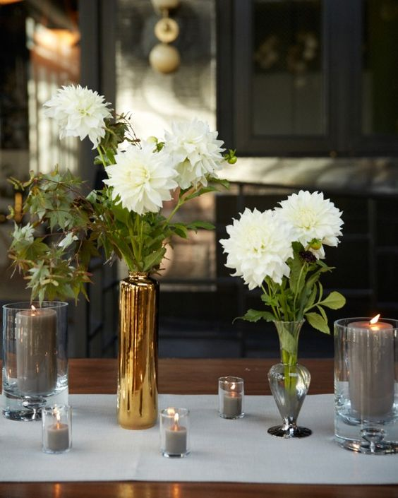 The space was decorated with white dahlias set in clear or gold vases and loads and loads of gray candles in varying sizes.