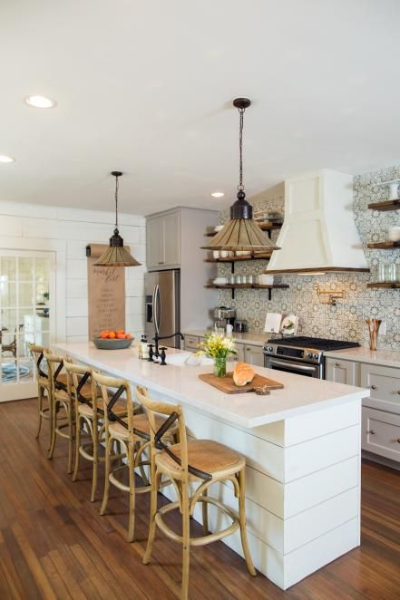 The+kitchen+of+the+newly+renovated+Childers+home+has+been+completely+transformed,+a+wall+was+removed+to+open+the+space,+a+custom+island+installed,+and+stainless+steel+appliances+were+added,+as+seen+on+Fixer+Upper.+(after):
