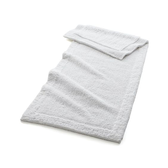 Cozy up your space with bathroom rugs from Crate and Barrel. Browse a variety of bath mats and rugs that are soft, absorbent and quick-drying. Order online.