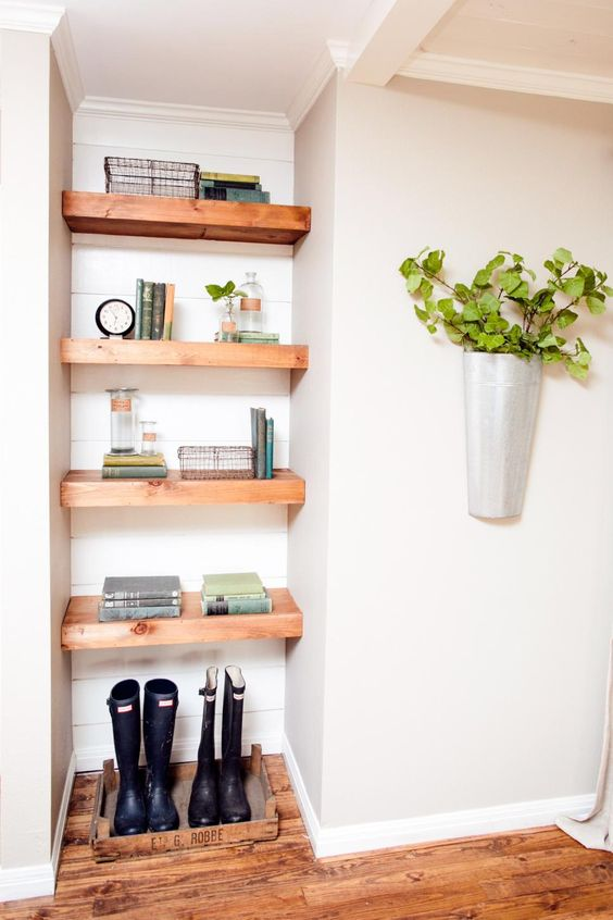 For an more contemporary look, Chip and Joanna Gaines paired painted shiplap siding with thick, streamlined wood shelves in this built-in shelving unit.: