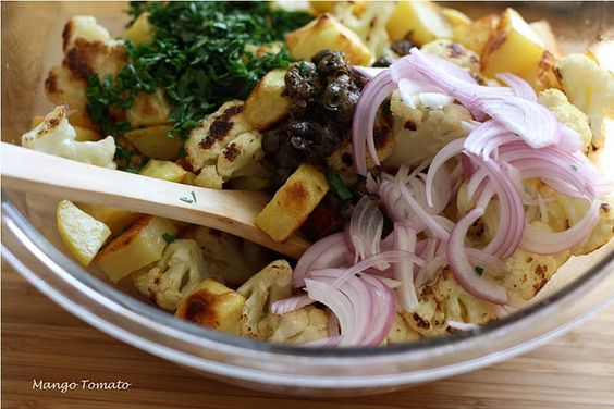 Roasted Potatoes and Cauliflower with Red Onion, Capers, and Chiles.  @Katie Leavitt This is the one we made in WA