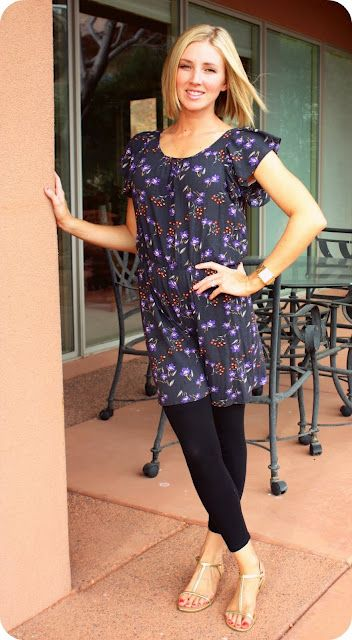 Tunic (?) with black leggings and sandals