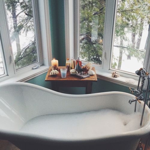 Now that is a tub to soak in! We love how it is placed by the window to enjoy that view!