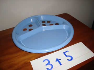 Buy a pack of plastic plates and add foam or paper numbers to add in the third section for the sum.